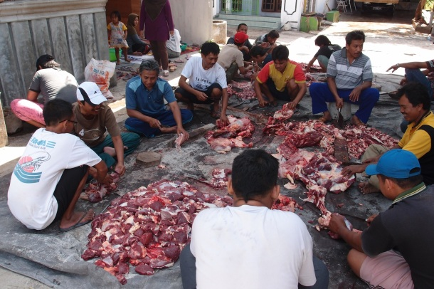 The scene I rolled into: all the neighborhood men butchering and dividing up 9 goats and one cow.